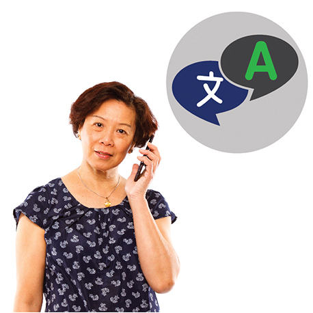 A woman talking on her mobile phone. Above her is an icon of speech bubbles with letters from different languages inside.